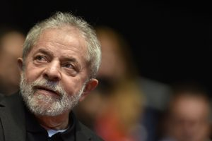 (FILES) This file photo taken on August 29, 2015 shows Brazilian former president (2003-2011) Luiz Inacio Lula Da Silva participating in the 12th Congress of the Brazilian Workers Union (CUT) in Belo Horizonte, Brazil, on August 28, 2015.  Brazil police search home on March 4, 2016 of ex-president Lula da Silva in corruption probe.  / AFP / DOUGLAS MAGNO